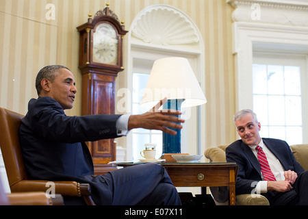 US President Barack Obama gestures during a meeting with Chief of Staff Denis McDonough in the Oval Office of the - Stock Photo