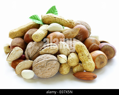 mix nuts - walnuts, hazelnuts, almonds, peanuts, pistachios on a white background - Stock Photo