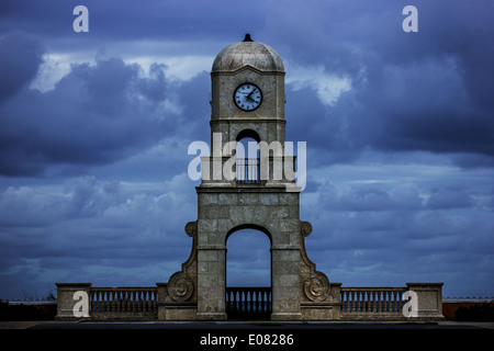 Clock Tower constructed with coral stone overlooks the Atlantic Ocean located at the end of Worth Avenue on Palm - Stock Photo