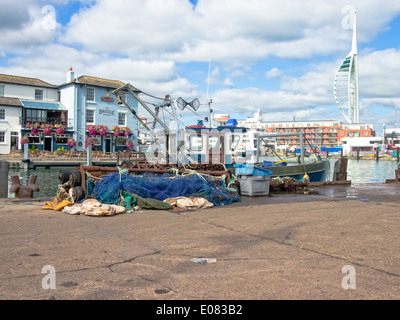Fishing boat and nets on the quayside of Camber Wharf in Old Portsmouth , England - Stock Photo