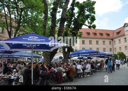 Beer garden of Weltenburg Abbey a Benedictine monastery in Weltenburg on the Danube in Bavaria, Germany. - Stock Photo