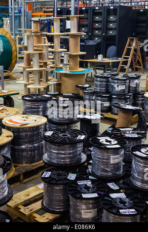 Many cable drums ready for a large electrical installation - Stock Photo