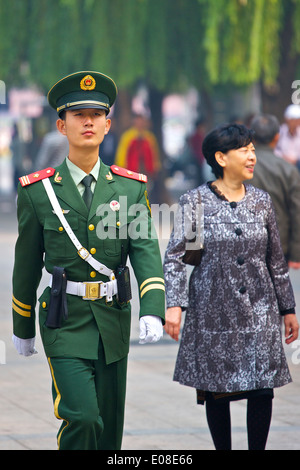 Marching Alone, Young Peoples Liberation Army Soldier Patrols The Streets In By Tiananmen Square, Beijing. - Stock Photo