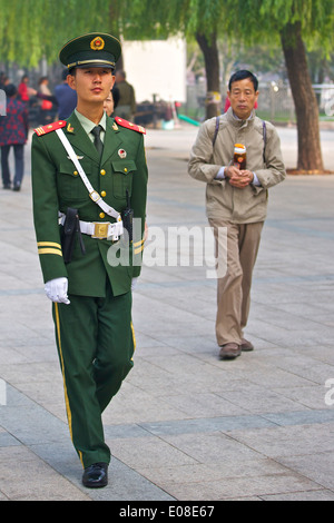 Young Chinese Soldier Patrols The Streets In Beijing, China. - Stock Photo