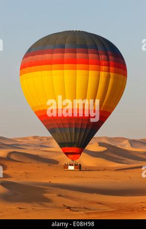 Fly over Dubai desert with hot air balloon - Stock Photo