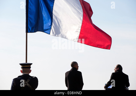 US President Barack Obama and President François Hollande of France stand under a French flag during the State Arrival - Stock Photo