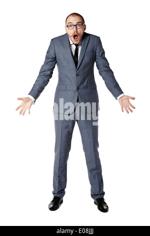 Youth businessman spreads his arms in bafflement. Man gesturing with hands. - Stock Photo