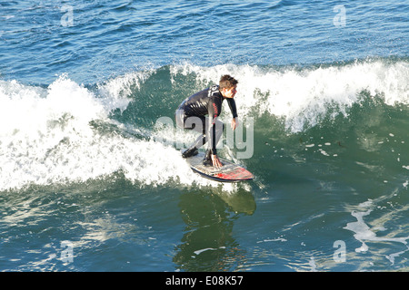 Pacific Surfer At Hermosa Beach, California. - Stock Photo