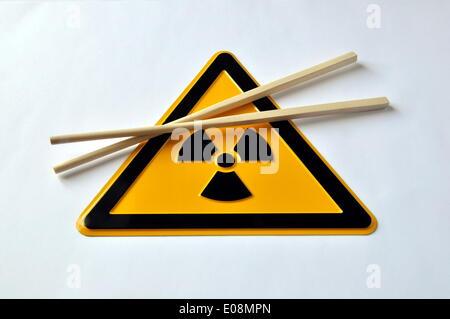Illustration - Chopsticks lie on a radioactive trefoil sign in Germany, 01 April 2011. Photo: Berliner Verlag/Steinach - Stock Photo
