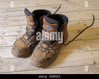 One pair of worn and dirty Lavoro brown walking boots - Stock Photo