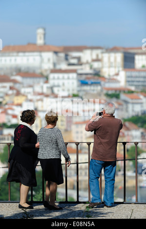 Tourists taking pictures in Coimbra, Portugal - Stock Photo