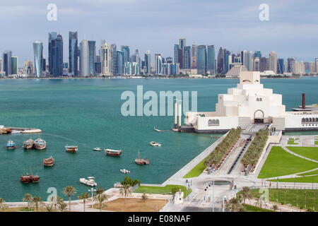 Elevated view over the Museum of Islamic Art and the Dhow harbour to the modern skyscraper skyline, Doha, Qatar, - Stock Photo