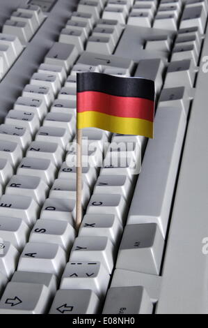 Illustration - A German flag is stuck in a keyboard in Germany, 27 April 2009. Photo: Berliner Verlag/S. Steinach - Stock Photo