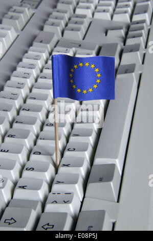 Illustration - A European flag is stuck in a keyboard in Germany, 27 April 2009. Photo: Berliner Verlag/S. Steinach - Stock Photo