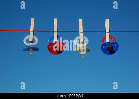 Illustration - A set of dummies hanging from a clothes line in Germany, 14 June 2013. Photo: Berliner Verlag/Steinach - Stock Photo