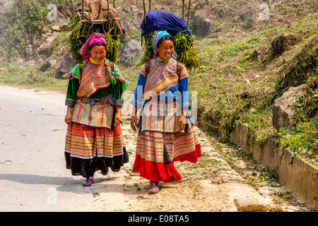 Young Women From The Flower Hmong Ethnic Group On Their Way To Market, Bac Ha, Lao Cai Province, Vietnam - Stock Photo