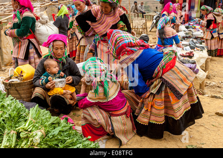Flower Hmong People At The Ethnic Market In Can Cau, Lao Cai Province, Vietnam - Stock Photo