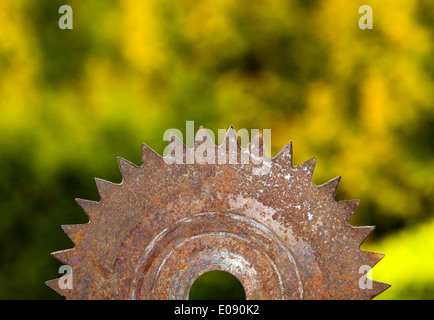 Old rusted metal blade on nature background - Stock Photo