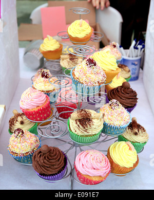 Various cup cakes for sale on a stall at the village carnival at Ashover, Derbyshire, England, UK. 2014. - Stock Photo