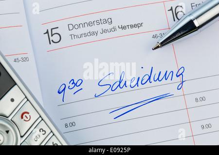 An appointment is put down in a calendar: Separation, Ein Termin ist in einem Kalender eingetragen: Scheidung - Stock Photo
