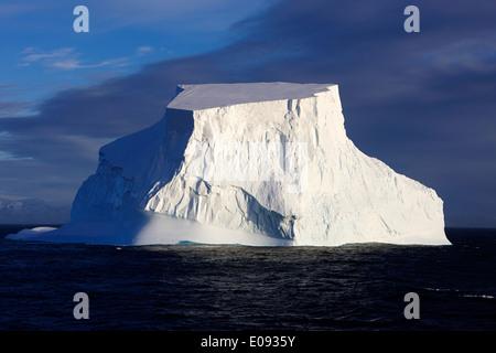 large tabular iceberg in the antarctic ocean Antarctica - Stock Photo