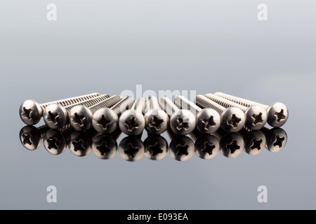 Different screws in the workshop in a trade company., Verschiedene Schrauben in der Werkstatt in einem Gewerbe Betrieb. - Stock Photo