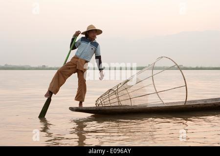 South East Asia Myanmar Burma Shan State Nyaung Shwe Lake Inle Intha leg rowing fisherman at dawn the fishermen - Stock Photo