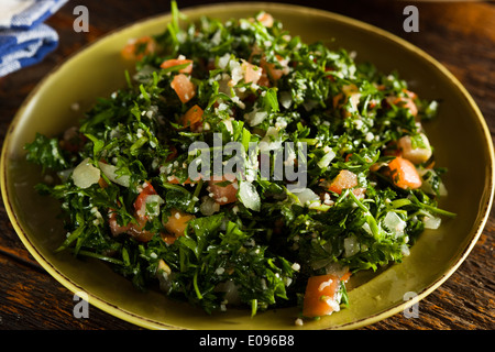 Healthy Organic Tabbouleh Salad with Tomatos and Parsley - Stock Photo