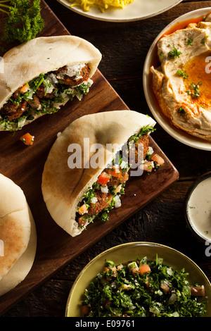 Healthy Vegetarian Falafel Pita with Rice and Salad - Stock Photo