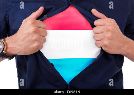 Young sport fan opening his shirt and showing the flag his country Luxembourg - Stock Photo
