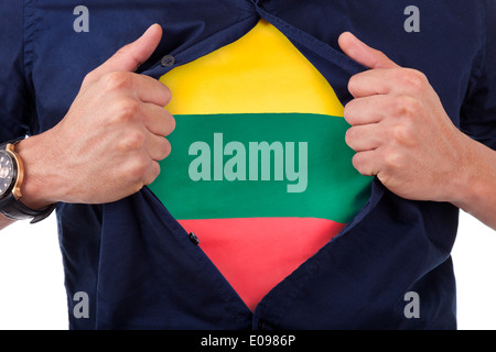Young sport fan opening his shirt and showing the flag his country Lithuania - Stock Photo