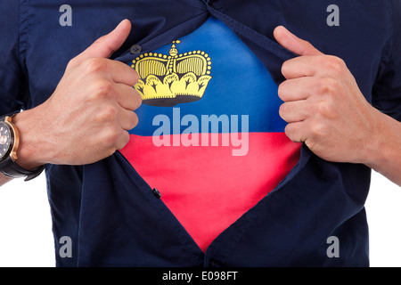 Young sport fan opening his shirt and showing the flag his country Lichtenstein - Stock Photo