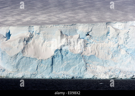 glacier face with blue and white ice arctowski peninsula Antarctica - Stock Photo