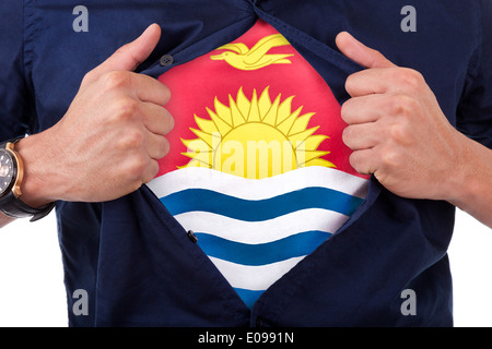 Young sport fan opening his shirt and showing the flag his country Kiribati - Stock Photo
