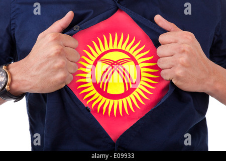 Young sport fan opening his shirt and showing the flag his country Kirghizistan - Stock Photo
