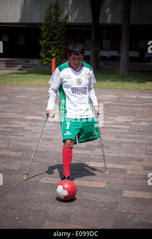 Mexico City, Mexico. 6th May, 2014. A man on crutches plays soccer during the 4th Fair of Rights of People with - Stock Photo