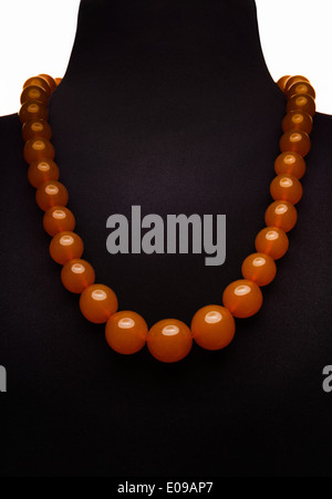 Amber necklace on black mannequin - Stock Photo