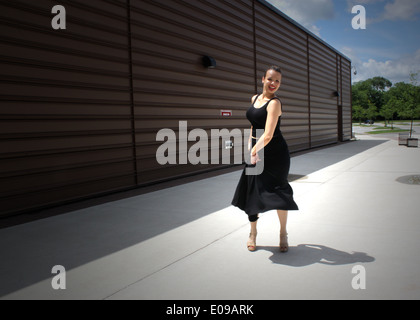 Girl in a black dress dances flamenco on the street in Toronto, Canada - Stock Photo