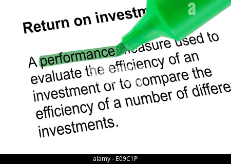 Highlighted word performance for Return on investment - ROI, with green pen over white paper. Isolated white background. - Stock Photo
