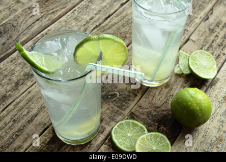 Cold drink with fresh lime and ice - Stock Photo