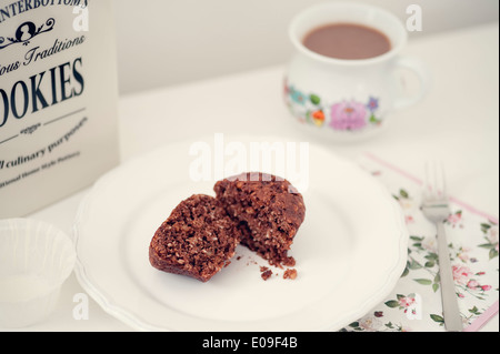 Vegan muffins with chocolate and nuts on plate - Stock Photo