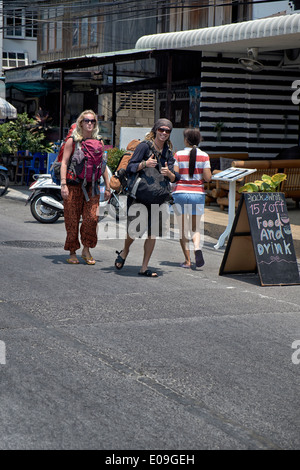 Backpacking couple touring Thailand S. E. Asia - Stock Photo