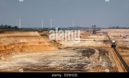 Germany, North Rhine-Westphalia, Garzweiler surface mine with wind turbines in background - Stock Photo