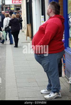 Obese man in street in town in Pembroke, Wales - Stock Photo