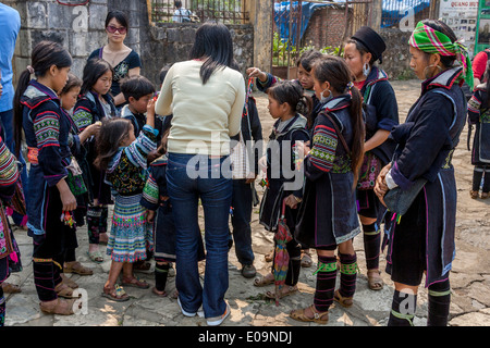 People From The Black Hmong Hill Tribe At The Market In Sa Pa, Lao Cai Province, Vietnam - Stock Photo