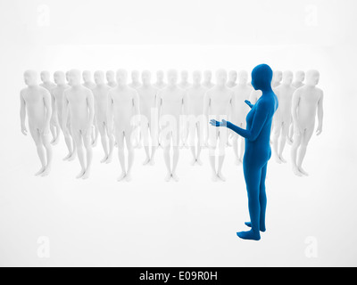 woman dressed in blue full body suit trains an army of white men - Stock Photo