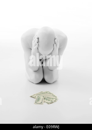 faceless man dressed in white, with pile of money in front, hopeless gesture - Stock Photo