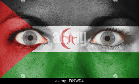 Close up of eyes. Painted face with flag of Western Sahara - Stock Photo