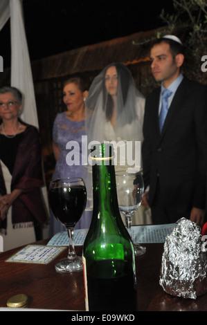 Jewish Wedding Bride and groom under the chupah - Stock Photo