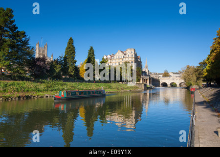 BATH, UK - OCT 20, 2012 : Canal boat on the River Avon with Pulteney Bridge, Weir, the Empire and Bath Abbey in - Stock Photo